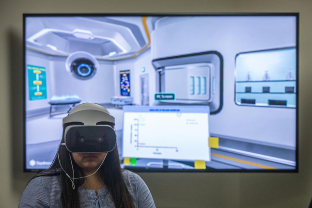 ASU biology student Victoria Quintana uses a VR headset during a trial run with Labster on the Tempe campus in June.
