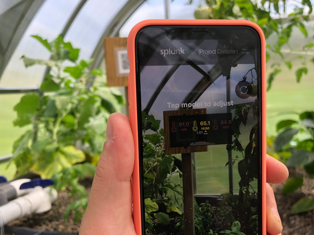 Students can use augmented reality to visualize water levels and other measurements throughout the aquaponics system.