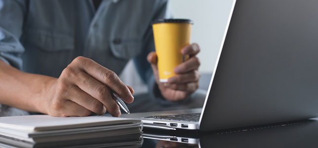 closeup of man working on laptop