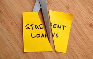 student loans being cut with scissors