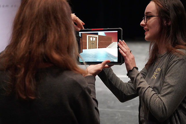An AR set design app allows Husson University theater students to visualize a set on stage before construction begins.
