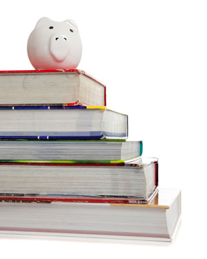 stack of textbooks with piggy bank on top