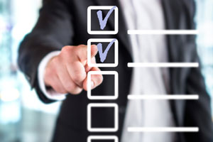 man pointing to checklist