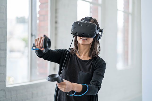 woman using virtual reality gear