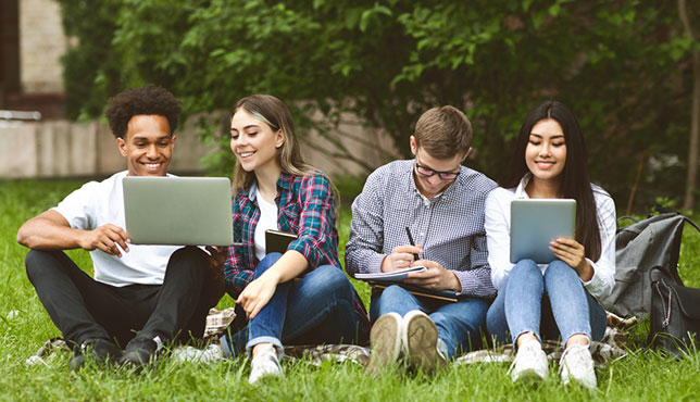 group of college students with their devices