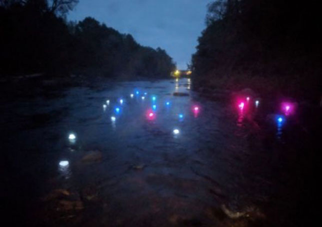 3D-printed LED-lighted vessels floating down the Grasse River in northern New York. When they reached a particular location, they automatically changed color to green.