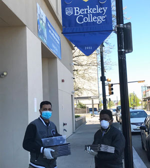 Berkeley College public safety staff prepare to distribute laptop computers to students at the start of the spring semester