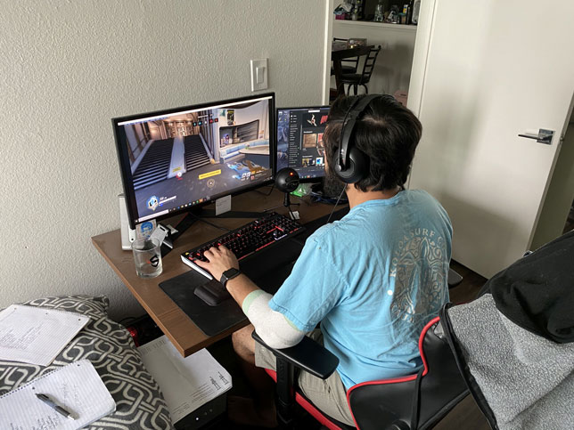 UCLA esports varsity player Naveen Sheik plays on the Overwatch team from his room during the COVID-19 pandemic