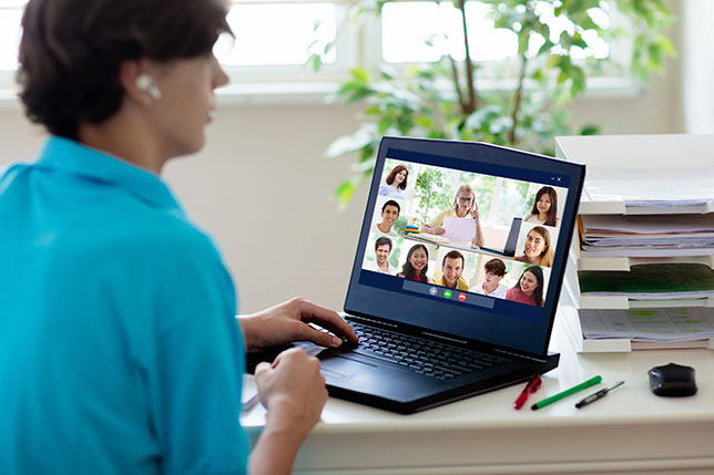 closeup of laptop with videoconference on screen