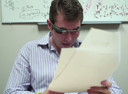 Teaching Assistant Adam Spencer usesGoogle Glass to record feedback for students as he goes over their work.
