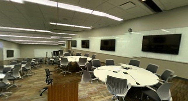 The new learning spaces include round, wired tables that let participants project their projects to computers in their groups or to classroom displays.