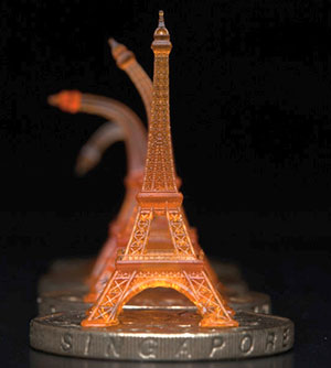 An Eiffel tower is bent, then straightens on its own to its original form after being heated through a Singapore dollar coin. Photo courtesy of Qi (Kevin) Ge.