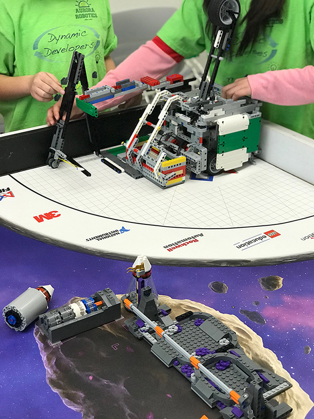 During the open house for the Urban STEM Education Center, student members of an area robotics club demonstrated a robot made out of Legos as part of the First Lego League, a competition for elementary and middle school students. Source: Urban STEM Education Center.