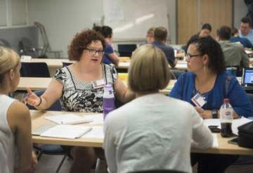 Teacher Laura Rangel, left, works with a group of other educators to plan a world history lesson using primary sources during a summer teaching event at the University of California, Davis. Source: UC Davis/Karin Higgins