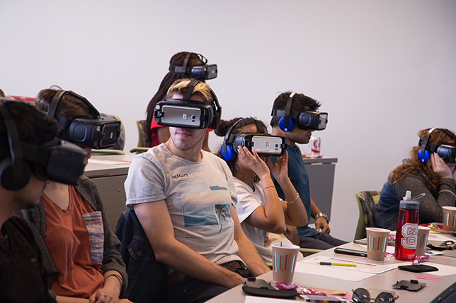 5c6a3720572f Students wear VR headsets to experience scenarios where cultural  differences impact the way people communicate.