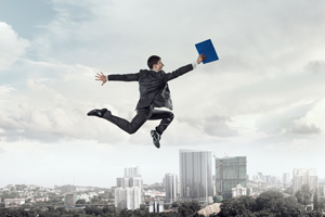 young businessman flying through air