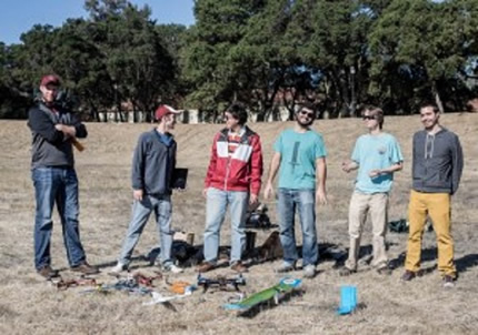 Three teams of Stanford students build their unmanned aerial vehicles and then used them to find four objects in an empty field in a timed competition.