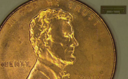 The radio chip designed at Stanford University is so small it's dwarfed by a penny.