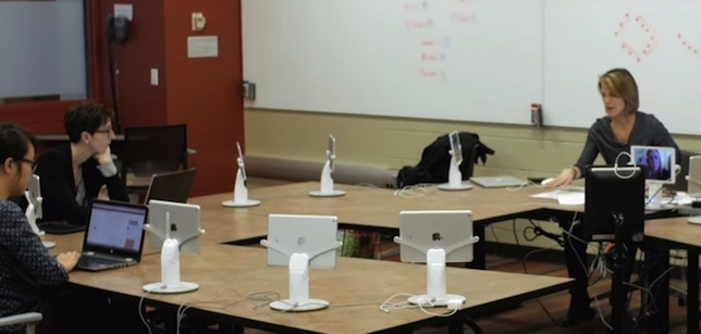 A doctoral program at Michigan State University has begun experimenting with the use of robots to pull on-campus and off-campus students closer together in class.
