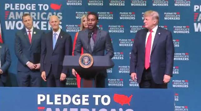 "David Thompson is welcomed to the stage by President Trump to share his CTE story; the 23-year-old Tampa Bay Technical High School graduate earns a ""six-figure"" income as a pipe welder. Source: Hillsborough Schools"